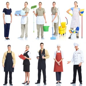 Young  smiling waiter chef and cleaner. Isolated over white back